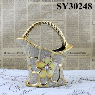 With golden flower galvanized flower vase